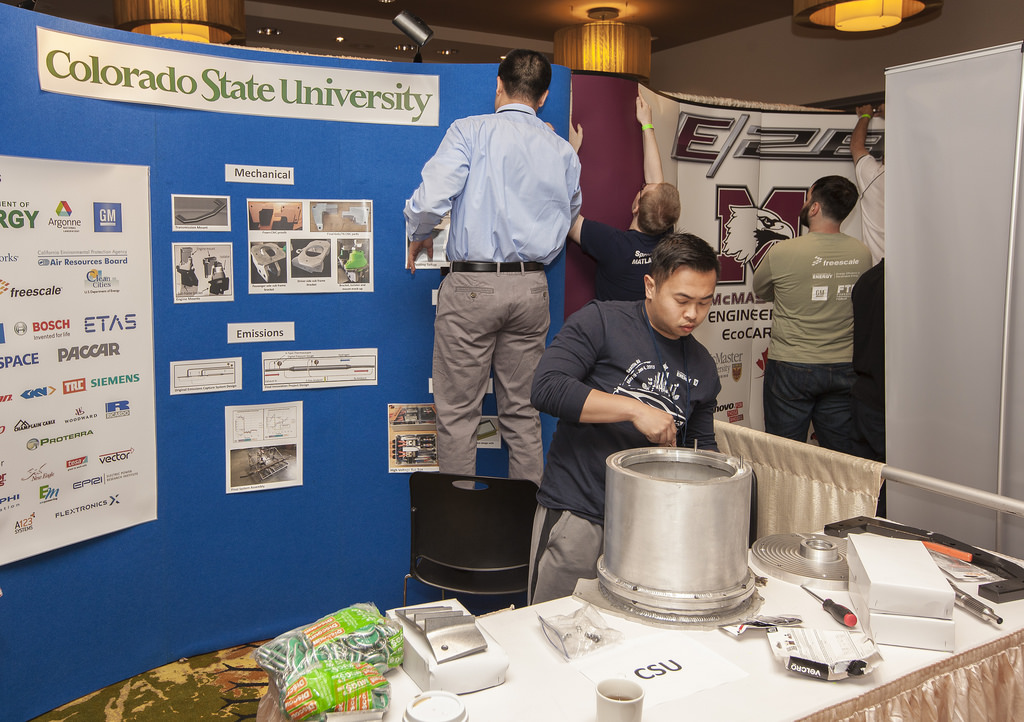 Two students at Colorado State University set up for a trade show.