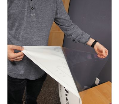 Backing is removed from the decal before placing on a wall