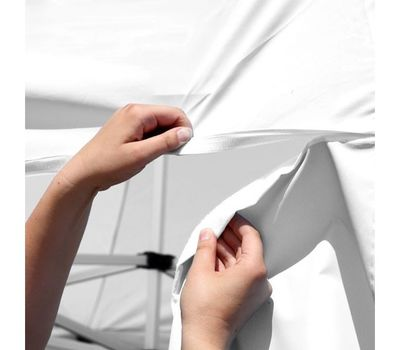 Using hook-and-loop tape, the banners easily and securely attach to the tent canopy