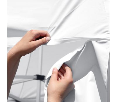 Tent wall attaches to canopy via hook-and-loop adhesive