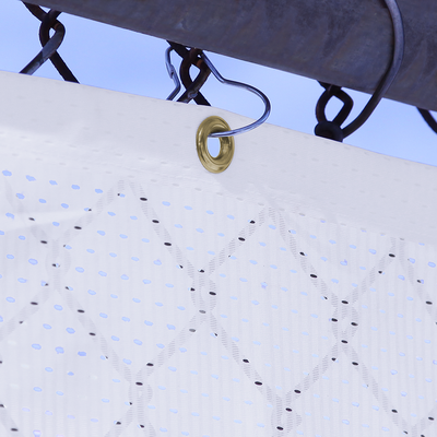 Brass grommet finishing displayed on a fence