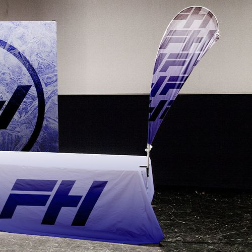 Display a feather flag on your table for further advertising space