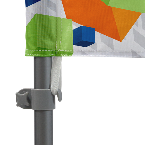 Flag attaches to pole set with tab