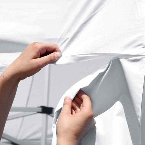 Tent wall attaches to canopy via hook-and-loop fastener