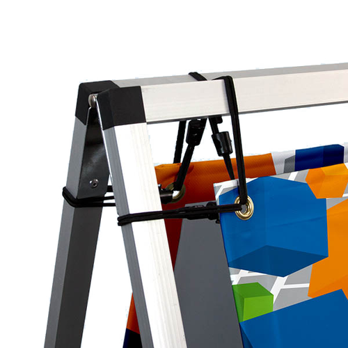 Print attaches to frame with black banner bungee cords